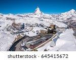 Matterhorn peak and Gornergrat railway station on top hill, Zermatt, Switzerland.