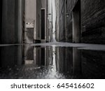 reflection of a dark city alley ... | Shutterstock . vector #645416602
