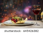 Glass of a red wine and salad - stock photo