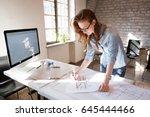 female designer in office...   Shutterstock . vector #645444466