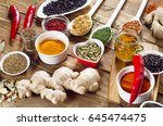 colorful spices on a wooden... | Shutterstock . vector #645474475