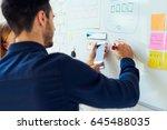closeup of ux designers... | Shutterstock . vector #645488035