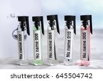 perfume samples in row  closeup | Shutterstock . vector #645504742