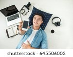 top view of asian man lying on... | Shutterstock . vector #645506002