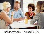 multi ethnic group having a... | Shutterstock . vector #645519172