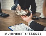 businessman giving money ... | Shutterstock . vector #645530386