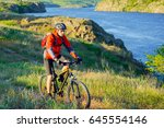 cyclist in red jacket riding... | Shutterstock . vector #645554146