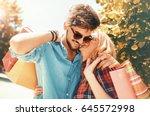beautiful young couple enjoying ... | Shutterstock . vector #645572998