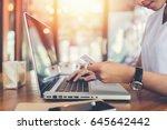 hands holding plastic credit... | Shutterstock . vector #645642442