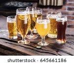 different glasses of beer on... | Shutterstock . vector #645661186