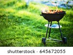 barbecue grill with fire on... | Shutterstock . vector #645672055