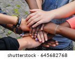multiracial teenagers joining... | Shutterstock . vector #645682768