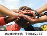 multiracial teenagers joining... | Shutterstock . vector #645682786