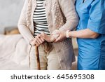 gentle trained nurse helping... | Shutterstock . vector #645695308