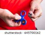 person holding dislodged weight ... | Shutterstock . vector #645700162