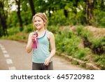 portrait of sporty smiling...   Shutterstock . vector #645720982
