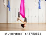 Small photo of Inversion bow pose in aero anti gravity yoga. Aerial exercises