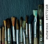 used paint brushes lying on the ... | Shutterstock . vector #645772168
