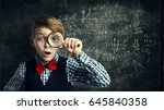 child magnifying glass  amazed... | Shutterstock . vector #645840358