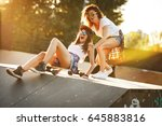two female friends playing with ... | Shutterstock . vector #645883816