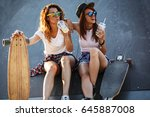 two female skaters friends... | Shutterstock . vector #645887008