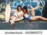 two female skaters friends... | Shutterstock . vector #645889075