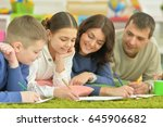 children draw with their parents | Shutterstock . vector #645906682