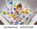 the child is sitting in an... | Shutterstock . vector #645931468