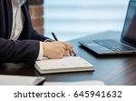 close up businessman signing... | Shutterstock . vector #645941632