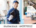portrait of an auto mechanic... | Shutterstock . vector #645970312