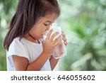 cute asian little girl drinking ... | Shutterstock . vector #646055602