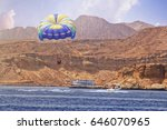 water sports parasailing at... | Shutterstock . vector #646070965
