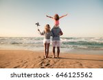 happy family on the beach.... | Shutterstock . vector #646125562