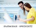 happy couple buying new smart... | Shutterstock . vector #646161652