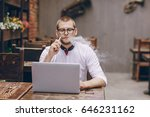 young man in cafe with laptop... | Shutterstock . vector #646231162