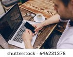 a young bank employee busy on a ... | Shutterstock . vector #646231378