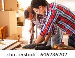 two carpenters working on... | Shutterstock . vector #646236202