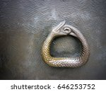 Small photo of Ouroboros symbol photo. Snake snapped into his tail. Symbol of infinity