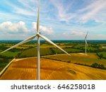 wind turbines in a field near... | Shutterstock . vector #646258018