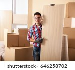 moving house workers setting up ... | Shutterstock . vector #646258702