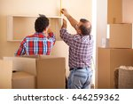 moving house workers setting up ... | Shutterstock . vector #646259362