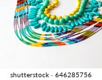 Small photo of beaded necklace from colorful beads in the white background