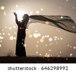 woman with her hands up on...   Shutterstock . vector #646298992