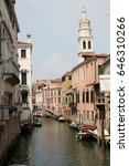 Small photo of Venice canal with boats, Italy