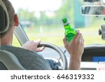 man driving a car with a bottle ... | Shutterstock . vector #646319332