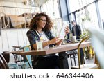 beautiful woman in city cafe.... | Shutterstock . vector #646344406