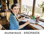 beautiful young painter in her... | Shutterstock . vector #646346656