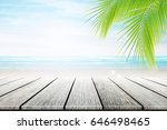 empty wooden table and palm... | Shutterstock . vector #646498465