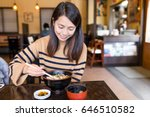 woman enjoy udon in japanese... | Shutterstock . vector #646510582
