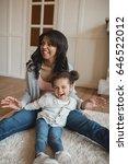 happy african american mother... | Shutterstock . vector #646522012